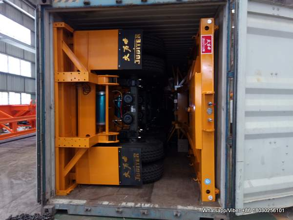 FLAT BED TRAILER LOAD INTO CONTAINER